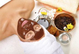 Beautiful woman with chocolate mask on her face